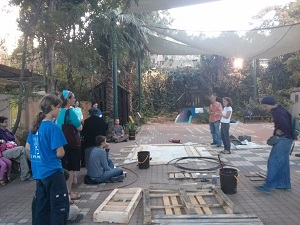 SPNI  Community Garden participants build a flower bed to prepare for the sabbatical year