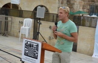 Braam Malherbe speaks at the annual ceremony for Welcoming the Swifts back to their nests at the Western Wall