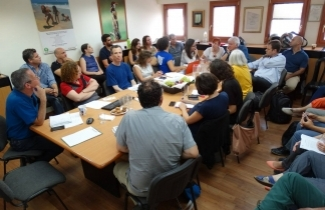 Representatives from 20 organizations join for an emergency meeting at SPNI headquarters. [Photo: Dov Greenblat]